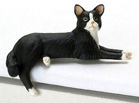 """Cat Laying Socks (1""""H x 2""""W x 1""""D)"""